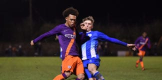 CLEVEDON, ENGLAND - DECEMBER 19: D'Margio Wright-Phillips of Manchester City is tackled by Will Symonds of Clevedon Town during the FA Youth Cup Third Round match between Clevedon Town and Manchester City at The Everyone Active Stadium on December 19, 2018 in Clevedon, England. (Photo by Dan Mullan/Getty Images)