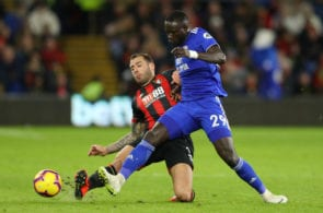 CARDIFF, WALES - FEBRUARY 02: Oumar Niasse of Cardiff City is challenged by Steve Cook of AFC Bournemouth during the Premier League match between Cardiff City and AFC Bournemouth at Cardiff City Stadium on February 2, 2019 in Cardiff, United Kingdom. (Photo by Warren Little/Getty Images)
