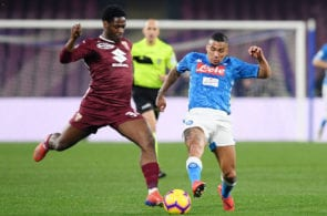 NAPLES, ITALY - FEBRUARY 17: Allan of SSC Napoli vies Ola Aina of Torino FC during the Serie A match between SSC Napoli and Torino FC at Stadio San Paolo on February 17, 2019 in Naples, Italy. (Photo by Francesco Pecoraro/Getty Images)