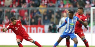 MUNICH, GERMANY - FEBRUARY 23: Salomon Kalou of Hertha BSC is challenged by Javi Martinez and Jerome Boateng of Bayern Munich during the Bundesliga match between FC Bayern Muenchen and Hertha BSC at Allianz Arena on February 23, 2019 in Munich, Germany. (Photo by Christian Kaspar-Bartke/Bongarts/Getty Images)