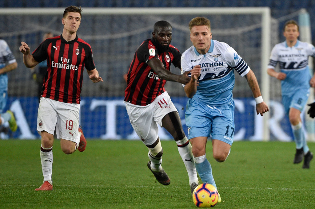 ROME, ITALY - FEBRUARY 26: Tiémoué Bakayoko of AC Milan challenges Ciro Immobile of SS Lazio during the Coppa Italia semi-final first leg between SS Lazio and AC Milan on February 26, 2019 in Rome, Italy. (Photo by Marco Rosi/Getty Images)