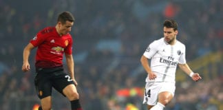 MANCHESTER, ENGLAND - FEBRUARY 12: Juan Bernat of PSG and Ander Herrera of Manchester United during the UEFA Champions League Round of 16 First Leg match between Manchester United and Paris Saint-Germain at Old Trafford on February 12, 2019 in Manchester, England. (Photo by Michael Steele/Getty Images)