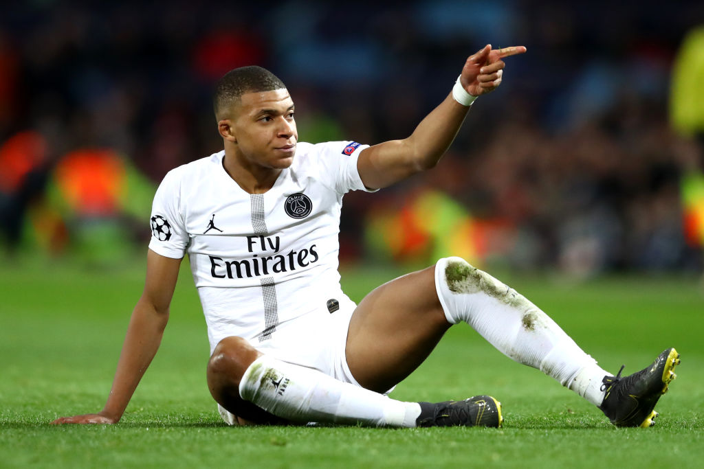 MANCHESTER, ENGLAND - FEBRUARY 12: Kylian Mbappe of PSG reacts after being tackled during the UEFA Champions League Round of 16 First Leg match between Manchester United and Paris Saint-Germain at Old Trafford on February 12, 2019 in Manchester, England. (Photo by Michael Steele/Getty Images)