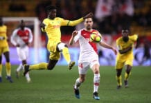 MONACO, MONACO - FEBRUARY 16: Edgar Ie of Nantes wins the ball in-front of Cesc Fabregas of Monaco during the Ligue 1 match between AS Monaco and FC Nantes at Stade Louis II on February 16, 2019 in Monaco, Monaco. (Photo by Alex Pantling/Getty Images)