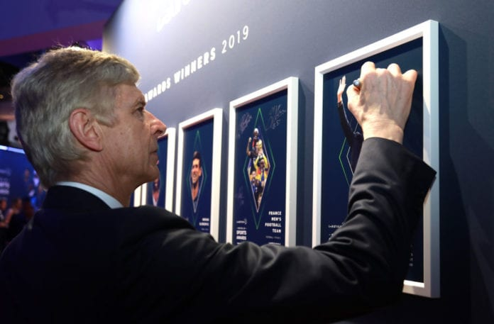 MONACO, MONACO - FEBRUARY 18: Arsene Wenger winner of the Laureus Lifetime Achievement award signs the wall during the 2019 Laureus World Sports Awards on February 18, 2019 in Monaco, Monaco. (Photo by Getty Images/Getty Images for Laureus)