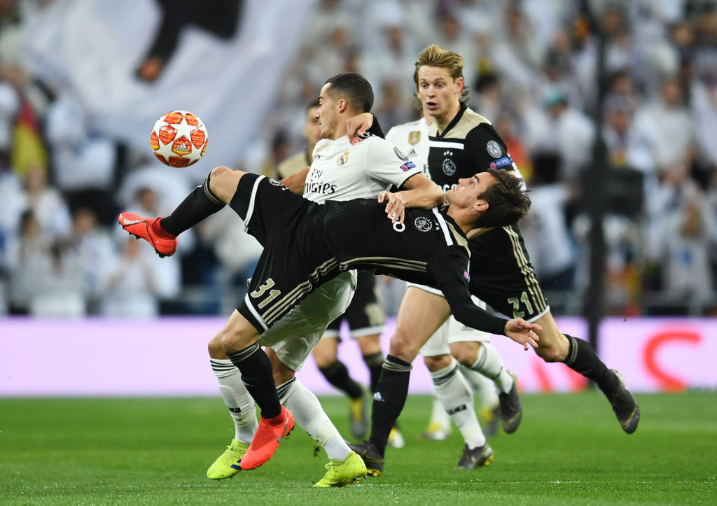 MADRID, SPAIN - MARCH 05: Lucas Vazquez of Real Madrid and Nicolas Tagliafico of Ajax tangle during the UEFA Champions League Round of 16 Second Leg match between Real Madrid and Ajax at Bernabeu on March 05, 2019 in Madrid, Spain. (Photo by David Ramos/Getty Images)