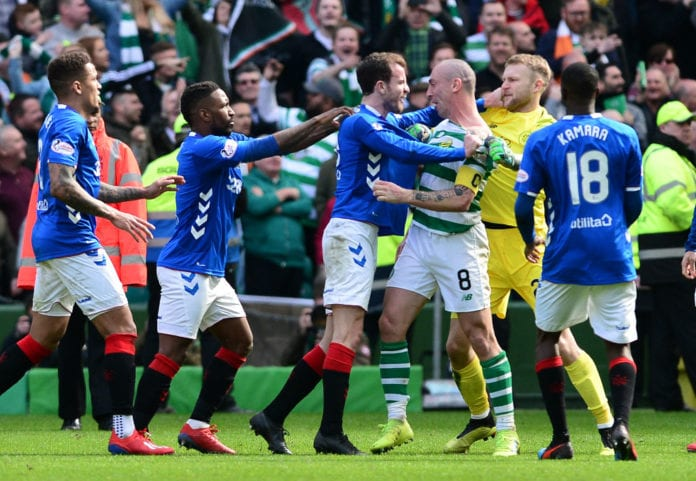 GLASGOW, SCOTLAND - MARCH 31: Scott Brown and Scott Bain of Celtic are confronted by Andy Halliday of Rangers at the final whistle during the Ladbrokes Scottish Premiership match between Celtic and Rangers at Celtic Park on March 31, 2019 in Glasgow, Scotland. (Photo by Mark Runnacles/Getty Images)