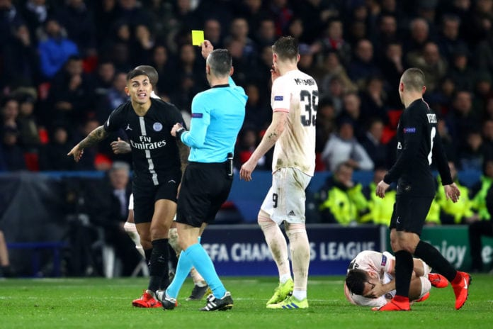 PARIS, FRANCE - MARCH 06: Leandro Daniel Peredes of PSG is shown a yellow card during the UEFA Champions League Round of 16 Second Leg match between Paris Saint-Germain and Manchester United at Parc des Princes on March 06, 2019 in Paris, . (Photo by Julian Finney/Getty Images)