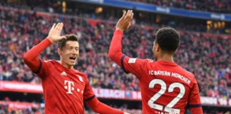 MUNICH, GERMANY - MARCH 09: Robert Lewandowski of Bayern Munich celebrates after scoring his team's second goal with teammate Serge Gnabry during the Bundesliga match between FC Bayern Muenchen and VfL Wolfsburg at Allianz Arena on March 09, 2019 in Munich, Germany. (Photo by Sebastian Widmann/Bongarts/Getty Images)