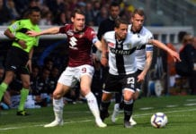 PARMA, ITALY - APRIL 06: Andrea Belotti of Torino FC competes for the ball with Marcello Gazzola of Parma Calcio during the Serie A match between Parma Calcio and Torino FC at Stadio Ennio Tardini on April 6 , 2019 in Parma, Italy. (Photo by Alessandro Sabattini/Getty Images)