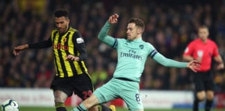 WATFORD, ENGLAND - APRIL 15: Aaron Ramsey of Arsenal in action with Etienne Capoue of Watford during the Premier League match between Watford FC and Arsenal FC at Vicarage Road on April 15, 2019 in Watford, United Kingdom. (Photo by Marc Atkins/Getty Images)