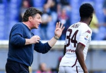 GENOA, ITALY - APRIL 20: Walter Mazzarri coach of Torino (left) issues some instructions to Temitayo Ola Aina of Torino during the Serie A match between Genoa CFC and Torino FC at Stadio Luigi Ferraris on April 20, 2019 in Genoa, Italy. (Photo by Paolo Rattini/Getty Images)