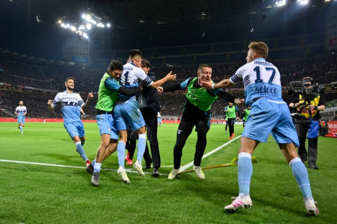 MILAN, ITALY - APRIL 24: Joaquin Correa of SS Lazio celebrates the opening goal with his team mates during the TIM Cup match between AC Milan and SS Lazio at Stadio Giuseppe Meazza on April 24, 2019 in Milan, Italy. (Photo by Marco Rosi/Getty Images)