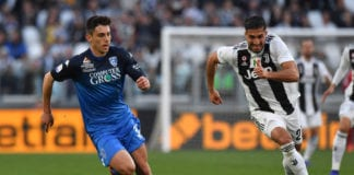 TURIN, ITALY - MARCH 30: Cristian Dell'Orco (L) of Empoli and Emre Can of Juventus compete for the ball during the Serie A match between Juventus and Empoli at Allianz Stadium on March 30, 2019 in Turin, Italy. (Photo by Tullio M. Puglia/Getty Images)