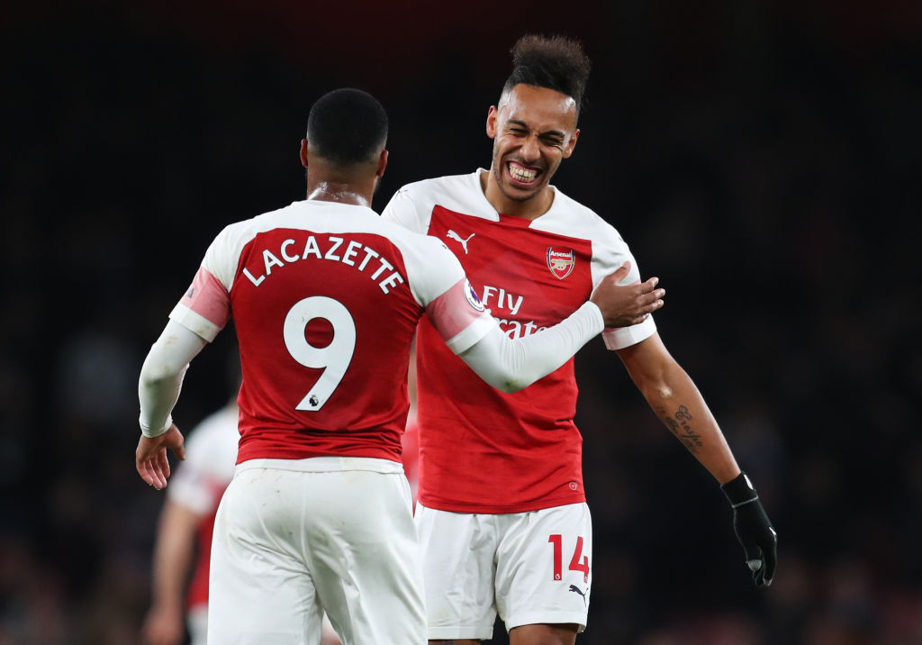 LONDON, ENGLAND - APRIL 01: Pierre-Emerick Aubameyang (14) and Alexandre Lacazette of Arsenal celebrate victory after the the Premier League match between Arsenal FC and Newcastle United at Emirates Stadium on April 01, 2019 in London, United Kingdom. (Photo by Catherine Ivill/Getty Images)