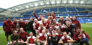 BRIGHTON, ENGLAND - APRIL 28: The Arsenal Women players and coaching staff celebrate winning the FA WSL League after the WSL match between Brighton and Hove Albion Women and Arsenal Women at Amex Stadium on April 28, 2019 in Brighton, England. (Photo by Steve Bardens/Getty Images)