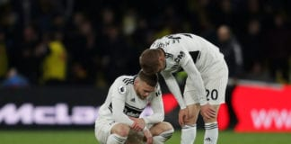 WATFORD, ENGLAND - APRIL 02: Calum Chambers and Maxime Le Marchand of Fulham look dejected after their team are relegated following the result in the Premier League match between Watford FC and Fulham FC at Vicarage Road on April 02, 2019 in Watford, United Kingdom. (Photo by Richard Heathcote/Getty Images)