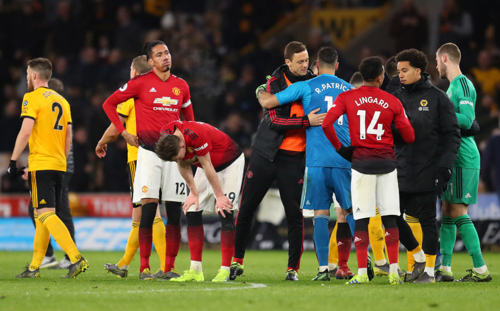 WOLVERHAMPTON, ENGLAND - APRIL 02: Chris Smalling of Manchester United and Scott McTominay of Manchester United look dejected following their sides defeat in the Premier League match between Wolverhampton Wanderers and Manchester United at Molineux on April 02, 2019 in Wolverhampton, United Kingdom. (Photo by Catherine Ivill/Getty Images)