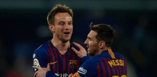 VILLARREAL, SPAIN - APRIL 02: Lionel Messi of Barcelona and Ivan Rakitic of Barcelona celebrate after the fourth goal of his team scored by Luis Suarez (not in frame) during the La Liga match between Villarreal CF and FC Barcelona at Estadio de la Ceramica on April 02, 2019 in Villareal, Spain. (Photo by Manuel Queimadelos Alonso/Getty Images)