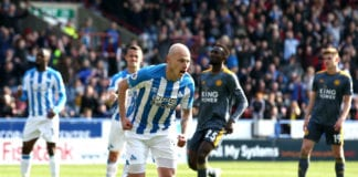 HUDDERSFIELD, ENGLAND - APRIL 06: Aaron Mooy of Huddersfield Town celebrates after scoring his team's first goal from the penalty spot during the Premier League match between Huddersfield Town and Leicester City at John Smith's Stadium on April 06, 2019 in Huddersfield, United Kingdom. (Photo by Jan Kruger/Getty Images)