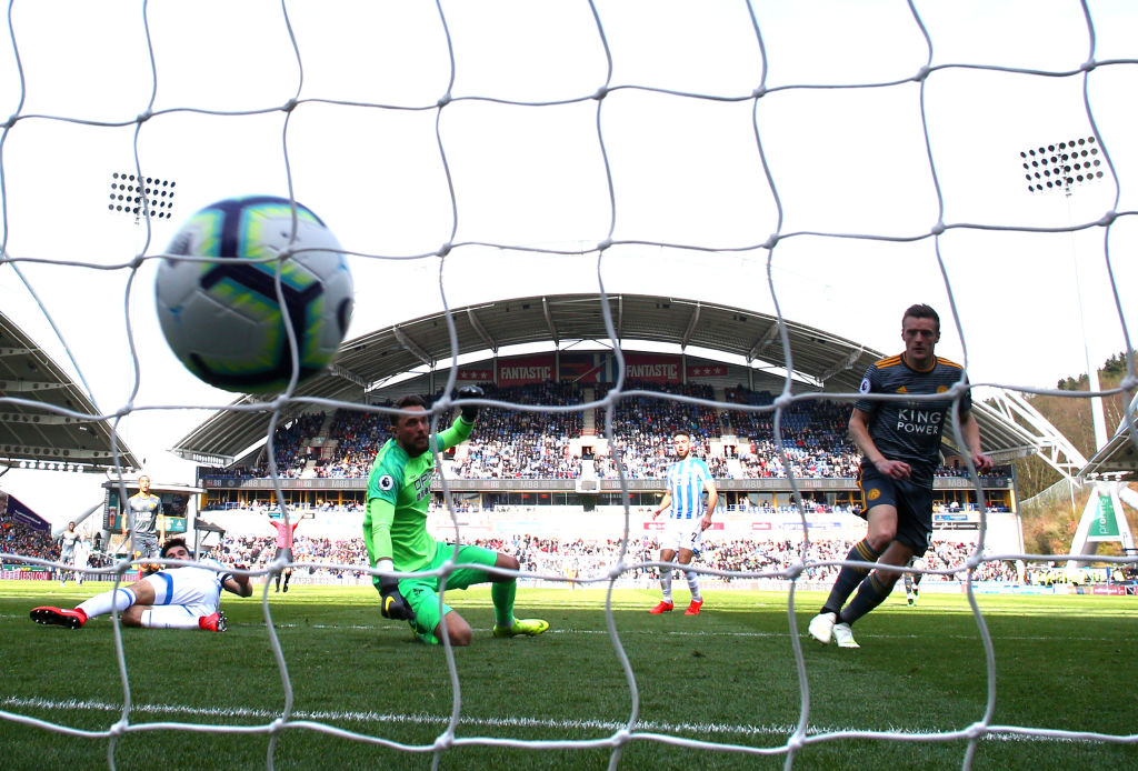 HUDDERSFIELD, ENGLAND - APRIL 06: Jamie Vardy of Leicester City scores his team's second goal past Ben Hamer of Huddersfield Town during the Premier League match between Huddersfield Town and Leicester City at John Smith's Stadium on April 06, 2019 in Huddersfield, United Kingdom. (Photo by Matthew Lewis/Getty Images)
