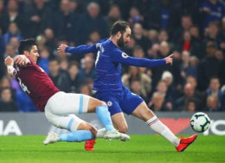 LONDON, ENGLAND - APRIL 08: Gonzalo Higuain of Chelsea shoots as Fabian Balbuena of West Ham United challenges during the Premier League match between Chelsea FC and West Ham United at Stamford Bridge on April 08, 2019 in London, United Kingdom. (Photo by Julian Finney/Getty Images)