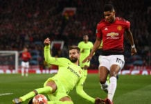 MANCHESTER, ENGLAND - APRIL 10: Gerard Pique of Barcelona tackles Marcus Rashford of Manchester United during the UEFA Champions League Quarter Final first leg match between Manchester United and FC Barcelona at Old Trafford on April 10, 2019 in Manchester, England. (Photo by Stu Forster/Getty Images)