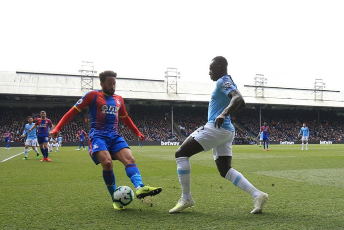 LONDON, ENGLAND - APRIL 14: Benjamin Mendy of Manchester City takes on Andros Townsend of Crystal Palace during the Premier League match between Crystal Palace and Manchester City at Selhurst Park on April 14, 2019 in London, United Kingdom. (Photo by Marc Atkins/Getty Images)
