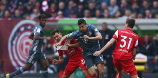 DUESSELDORF, GERMANY - APRIL 14: Robert Lewandowski of Muenchen is challenged by Dawid Kownacki and Marcel Sobottka of Duesseldorf during the Bundesliga match between Fortuna Duesseldorf and FC Bayern Muenchen at Esprit-Arena on April 14, 2019 in Duesseldorf, Germany. (Photo by Lars Baron/Bongarts/Getty Images)