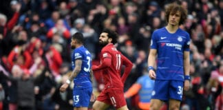 LIVERPOOL, ENGLAND - APRIL 14: Mohamed Salah of Liverpool (11) celebrates after scoring his team's second goal during the Premier League match between Liverpool FC and Chelsea FC at Anfield on April 14, 2019 in Liverpool, United Kingdom. (Photo by Michael Regan/Getty Images)