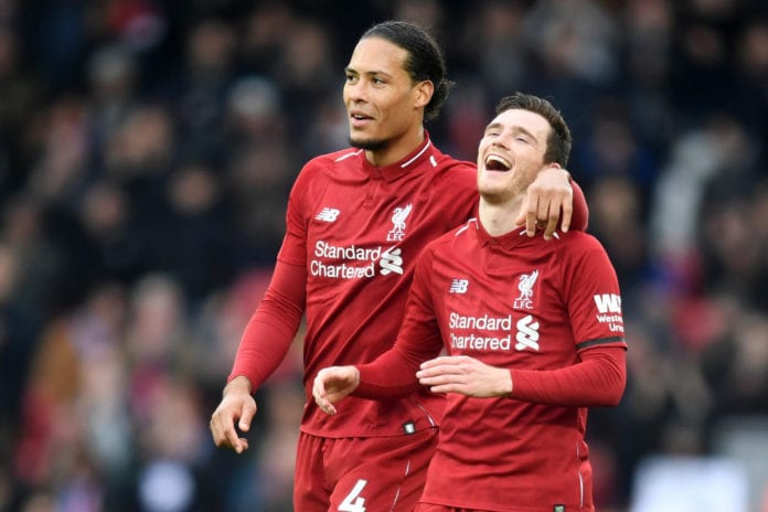LIVERPOOL, ENGLAND - APRIL 14: Andy Robertson and Virgil van Dijk of Liverpool celebrate victory after the Premier League match between Liverpool FC and Chelsea FC at Anfield on April 14, 2019 in Liverpool, United Kingdom. (Photo by Michael Regan/Getty Images)
