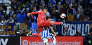 LEGANES, SPAIN - APRIL 15: Federico Valverde of Real Madrid tackles Javi Eraso of Leganes during the La Liga match between CD Leganes and Real Madrid CF at Estadio Municipal de Butarque on April 15, 2019 in Leganes, Spain. (Photo by Denis Doyle/Getty Images)