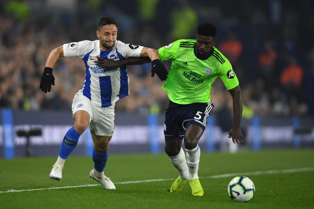 BRIGHTON, ENGLAND - APRIL 16: Florin Andone of Brighton & Hove Albion is challenged by Bruno Ecuele Manga of Cardiff City during the Premier League match between Brighton & Hove Albion and Cardiff City at American Express Community Stadium on April 16, 2019 in Brighton, United Kingdom. (Photo by Mike Hewitt/Getty Images)