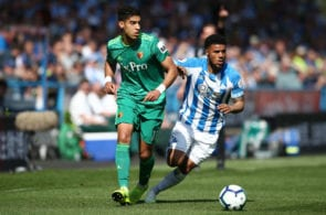 HUDDERSFIELD, ENGLAND - APRIL 20: Adam Masina of Watford battles for possession with Elias Kachunga of Huddersfield Town during the Premier League match between Huddersfield Town and Watford FC at John Smith's Stadium on April 20, 2019 in Huddersfield, United Kingdom. (Photo by Jan Kruger/Getty Images)