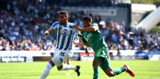 HUDDERSFIELD, ENGLAND - APRIL 20: Karlan Grant of Huddersfield Town battles for possession with Adrian Mariappa of Watford during the Premier League match between Huddersfield Town and Watford FC at John Smith's Stadium on April 20, 2019 in Huddersfield, United Kingdom. (Photo by Nathan Stirk/Getty Images)