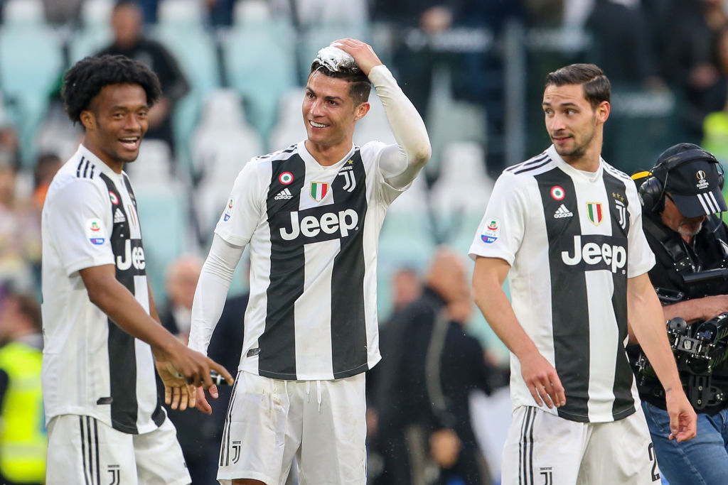 TURIN, ITALY - APRIL 20: Cristiano Ronaldo of Juventus celebrates with his teammates after winning the Italian league at the end of the Serie A match between Juventus and ACF Fiorentina on April 20, 2019 in Turin, Italy. (Photo by Giampiero Sposito/Getty Images)