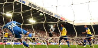 NEWCASTLE UPON TYNE, ENGLAND - APRIL 20: Ayoze Perez scores his and Newcastle's third and hat trick goal past goalkeeper Angus Gunn during the Premier League match between Newcastle United and Southampton FC at St. James Park on April 20, 2019 in Newcastle upon Tyne, United Kingdom. (Photo by Stu Forster/Getty Images)