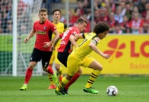 FREIBURG IM BREISGAU, GERMANY - APRIL 21: Janik Haberer (L) of Freiburg challenges Axel Witsel of Dortmund during the Bundesliga match between Sport-Club Freiburg and Borussia Dortmund at Schwarzwald-Stadion on April 21, 2019 in Freiburg im Breisgau, Germany. (Photo by Christian Kaspar-Bartke/Bongarts/Getty Images)
