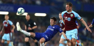 LONDON, ENGLAND - APRIL 22: Chris Wood of Burnley pulls back Andreas Christiensen of Chelsea during the Premier League match between Chelsea FC and Burnley FC at Stamford Bridge on April 22, 2019 in London, United Kingdom. (Photo by Clive Rose/Getty Images)