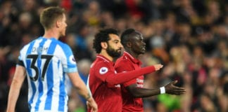 LIVERPOOL, ENGLAND - APRIL 26: Sadio Mane of Liverpool (R) celebrates as he scores his team's second goal with Mohamed Salah during the Premier League match between Liverpool FC and Huddersfield Town at Anfield on April 26, 2019 in Liverpool, United Kingdom. (Photo by Michael Regan/Getty Images)