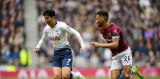 LONDON, ENGLAND - APRIL 27: Heung-Min Son of Tottenham Hotspur runs with the ball under pressure from Ryan Fredericks of West Ham United during the Premier League match between Tottenham Hotspur and West Ham United at Tottenham Hotspur Stadium on April 27, 2019 in London, United Kingdom. (Photo by Shaun Botterill/Getty Images)
