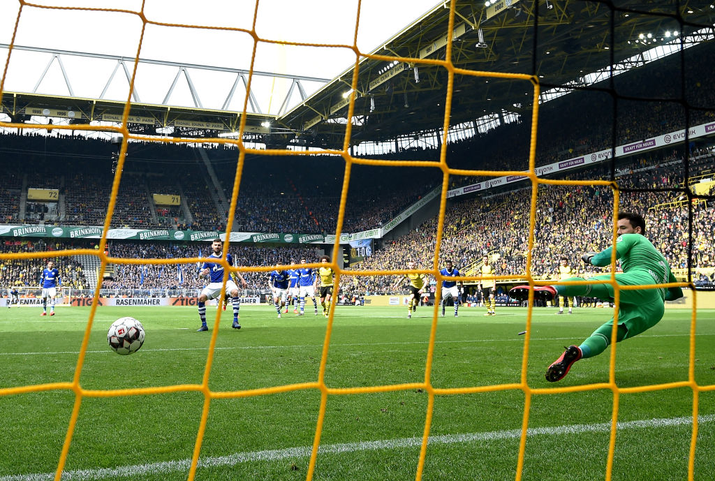 DORTMUND, GERMANY - APRIL 27: Daniel Caligiuri of FC Schalke 04 scores his team's first goal from a penalty past Roman Buerki of Borussia Dortmund during the Bundesliga match between Borussia Dortmund and FC Schalke 04 at Signal Iduna Park on April 27, 2019 in Dortmund, Germany. (Photo by Stuart Franklin/Bongarts/Getty Images)