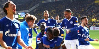 DORTMUND, GERMANY - APRIL 27: Breel Embolo of FC Schalke 04 celebrates with teammates after scoring his team's fourth goal during the Bundesliga match between Borussia Dortmund and FC Schalke 04 at Signal Iduna Park on April 27, 2019 in Dortmund, Germany. (Photo by Martin Rose/Bongarts/Getty Images)