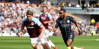 BURNLEY, ENGLAND - APRIL 28: Raheem Sterling of Manchester City takes on James Tarkowski of Burnley during the Premier League match between Burnley FC and Manchester City at Turf Moor on April 28, 2019 in Burnley, United Kingdom. (Photo by Michael Regan/Getty Images)