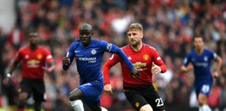 MANCHESTER, ENGLAND - APRIL 28: N'golo Kante of Chelsea and Luke Shaw of Manchester United chase the ball during the Premier League match between Manchester United and Chelsea FC at Old Trafford on April 28, 2019 in Manchester, United Kingdom. (Photo by Shaun Botterill/Getty Images)