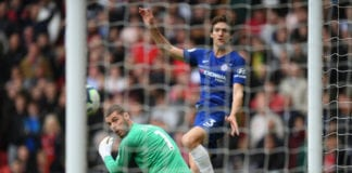 MANCHESTER, ENGLAND - APRIL 28: David De Gea of Manchester United watches the ball as Marcos Alonso of Chelsea scores during the Premier League match between Manchester United and Chelsea FC at Old Trafford on April 28, 2019 in Manchester, United Kingdom. (Photo by Shaun Botterill/Getty Images)
