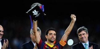 BARCELONA, SPAIN - AUGUST 28: Xavi Hernandez of FC Barcelona holds up the trophy after winning the Spanish Super Cup during the Spanish Super Cup second leg match between FC Barcelona and Atletico de Madrid at Nou Camp on August 28, 2013 in Barcelona, Spain. (Photo by David Ramos/Getty Images)