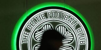 GLASGOW, SCOTLAND - NOVEMBER 26: A fan walks past a Celtic logo prior to the UEFA Europa League Group A match between Celtic FC and AFC Ajax at Celtic Park on November 26, 2015 in Glasgow, United Kingdom. (Photo by Mark Runnacles/Getty Images)