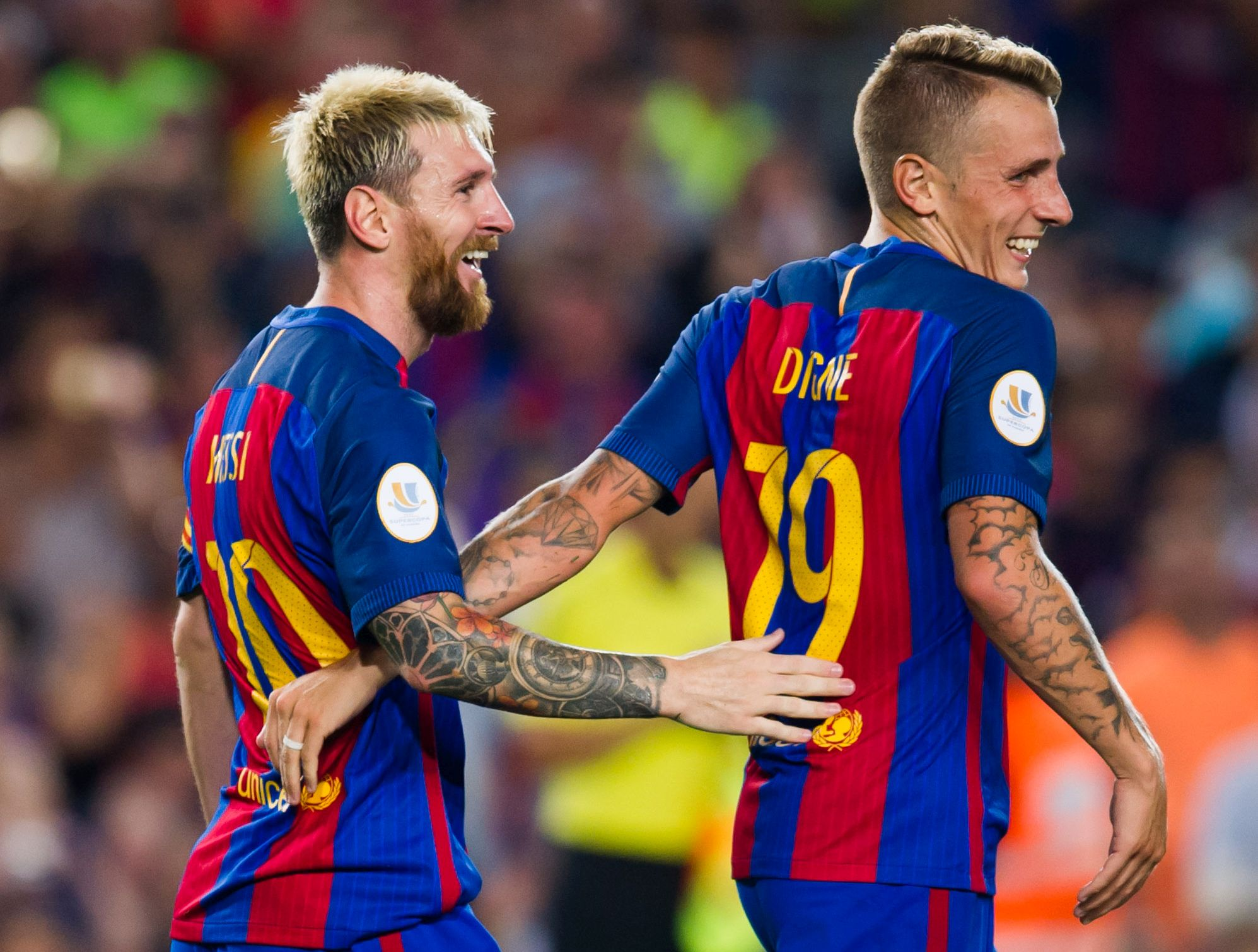 BARCELONA, SPAIN - AUGUST 17: Lionel Messi (L) of FC Barcelona celebrates with his teammate Lucas Digne after scoring his team's third goal during the Spanish Super Cup Final second leg match between FC Barcelona and Sevilla FC at Camp Nou on August 17, 2016 in Barcelona, Spain. (Photo by Alex Caparros/Getty Images)