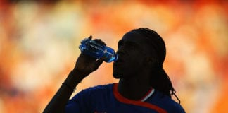 BASEL, SWITZERLAND - JUNE 21: Mario Melchiot of Netherlands has a drink prior to the UEFA EURO 2008 Quarter Final match between Netherlands and Russia at St. Jakob-Park on June 21, 2008 in Basel, Switzerland. (Photo by Lars Baron/Bongarts/Getty Images)